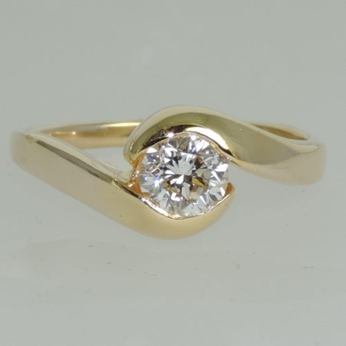 Diamond Solitaire Engagement ring in 14k
