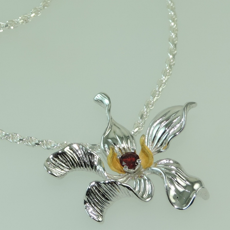 Hibiscus and Garnet Pendant in Sterling Silver flat